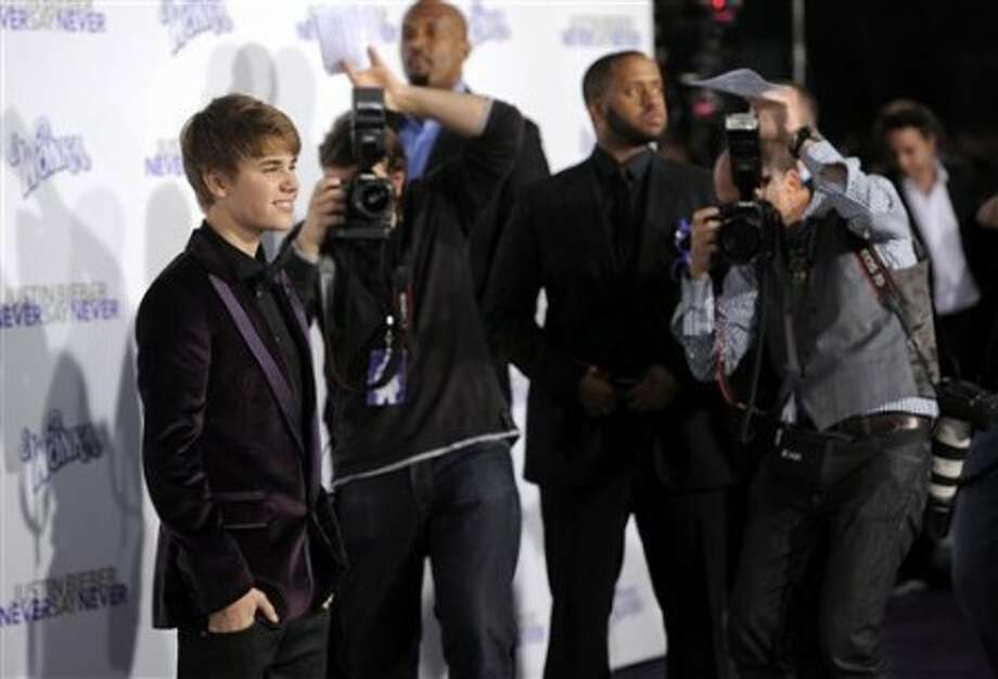 "Justin Bieber, subject of the documentary film ""Justin Bieber: Never Say Never,"" poses at the premiere of the film in Los Angeles, Tuesday, Feb. 8, 2011. (AP Photo/Chris Pizzello)"