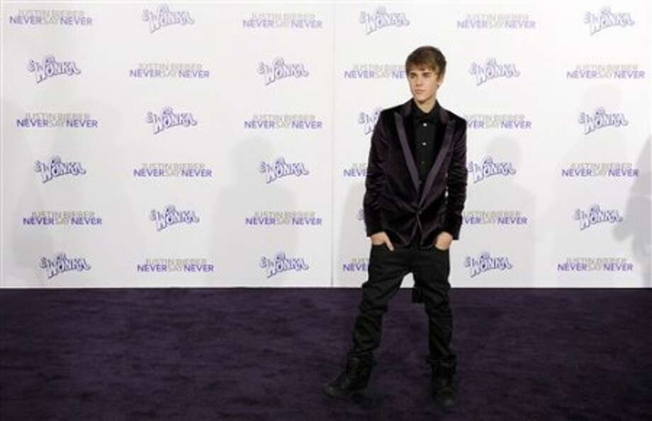 "Justin Bieber poses at the premiere of the documentary film ""Justin Bieber: Never Say Never,"" in Los Angeles, Tuesday, Feb. 8, 2011. (AP Photo/Chris Pizzello)"