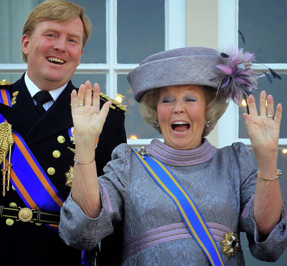 FILE - In this Sept. 21, 2010 file photo Dutch Queen Beatrix, right, and Dutch Crown Prince Willem-Alexander, left, wave to wellwishers from the balcony of Royal Palace Noordeinde after the Queen officially opened the new parliamentary year in The Hague, Netherlands. The Dutch Royal House says Queen Beatrix will deliver a nationally televised speech on Monday, Jan. 28, 2013 and speculation is growing that the popular monarch will announce she is to abdicate in favor of Crown Prince Willem Alexander. Beatrix, who turns 75 on Thursday, has ruled the nation of 16 million for more than 32 years and would be succeeded by her eldest son, Crown Prince Willem-Alexander. (AP Photo/Peter Dejong, File) / AP