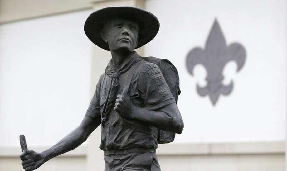 A statue of a Boy Scout stands in front of the National Scouting Museum, Monday, Jan. 28, 2013, in Irving, Texas. The Boy Scouts of America announced it is considering a dramatic retreat from its controversial policy of excluding gays as leaders and youth members. (AP Photo/LM Otero) / AP