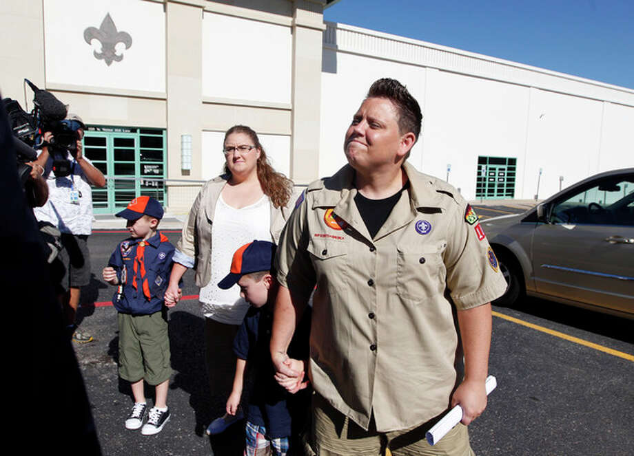 FILE - In this July 18, 2012 file photo, Jennifer Tyrrell, right, arrives for a meeting at the Boys Scouts of America national offices in Irving, Texas, with her son Jude Burns, 5, second from right, partner Alicia Burns, and son Cruz Burns, 7, left. The Ohio woman was ousted as a den mother because she is a lesbian. The Boys Scouts of America announced Monday, Jan. 28, 2013, that it is considering a dramatic retreat from its controversial policy of excluding gays as leaders and youth members. (AP Photo/LM Otero, File) / AP