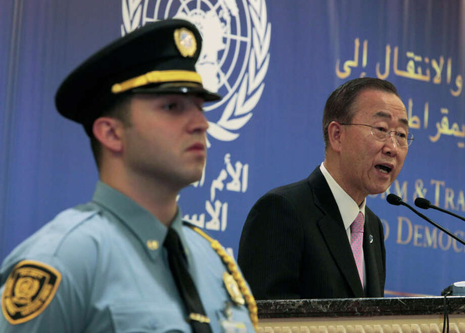 """U.N. Secretary-General Ban Ki-moon, right, speaks during the opening session of a conference on democracy in the Arab world, in Beirut, Lebanon, Sunday Jan. 15, 2012. Ban demanded Sunday that Syria's president stop killing his own people, and said the """"old order"""" of one-man rule and family dynasties is over in the Middle East. (AP Photo/Hussein Malla) / AP"""