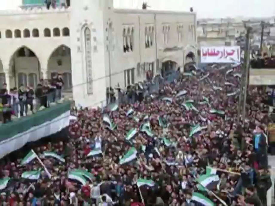 This image from amateur video made available by Shaam News Network on Friday, Jan. 13, 2012, purports to show a rally in support of the Free Syrian Army in Hama, Syria. (AP Photo/Shaam News Network via APTN) THE ASSOCIATED PRESS CANNOT INDEPENDENTLY VERIFY THE CONTENT, DATE, LOCATION OR AUTHENTICITY OF THIS MATERIAL. TV OUT / Shaam News Network
