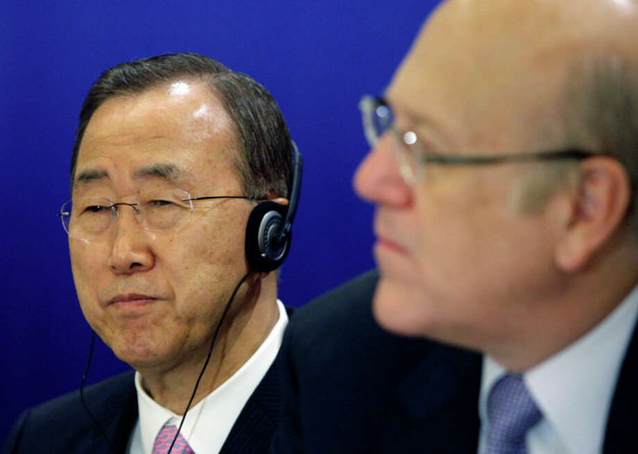 "U.N. Secretary-General Ban Ki-moon, left, and Lebanese Prime Minister Najib Mikati attend the opening session of a conference on democracy in the Arab world, in Beirut, Lebanon, Sunday Jan. 15, 2012. Ban demanded Sunday that Syria's president stop killing his own people, and said the ""old order"" of one-man rule and family dynasties is over in the Middle East. (AP Photo/Bilal Hussein) / AP"