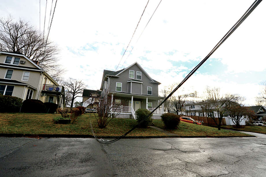 Heavy winds associated with a storm that effected the area early Thursday morning brought down wires and trees throughout Norwalk including Magnolia St. Hour photo / Erik Trautmann / (C)2012, The Hour Newspapers, all rights reserved