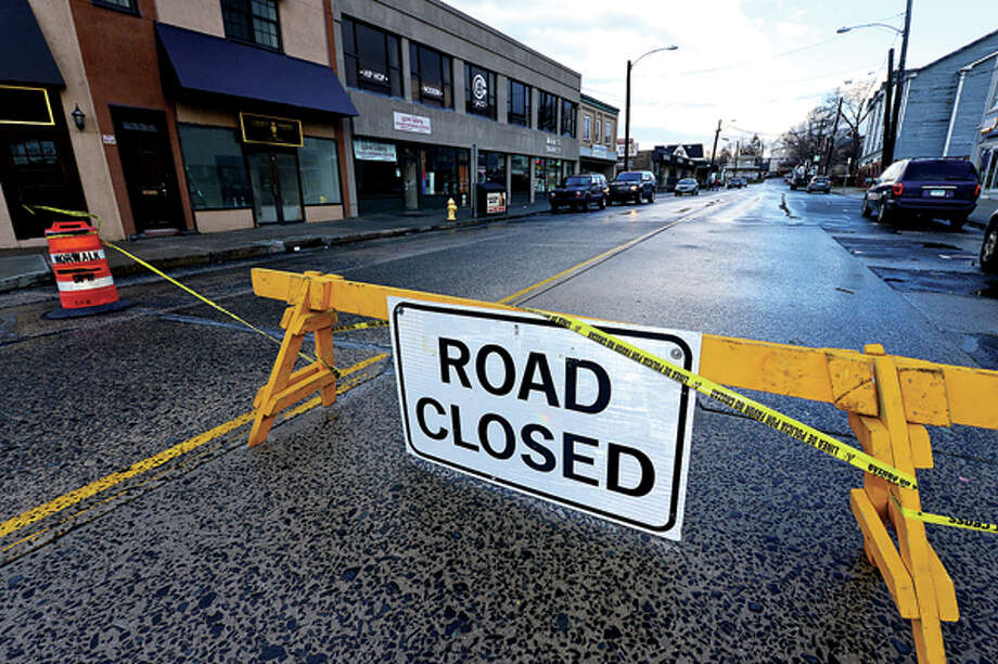 Heavy winds associated with a storm that effected the area early Thursday morning brought down wires and trees throughout Norwalk that closed a portion of Main St. Hour photo / Erik Trautmann / (C)2012, The Hour Newspapers, all rights reserved