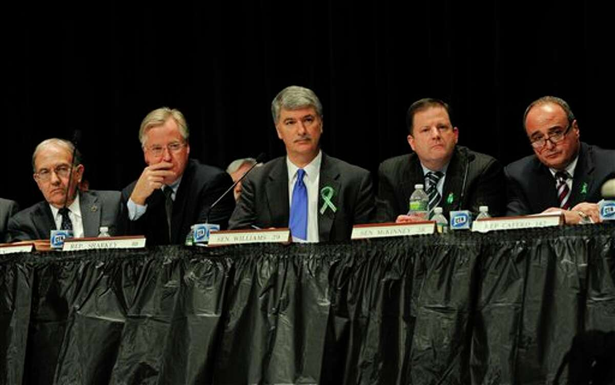 From the left, Connecticut State Senate Majority Leader Martin Looney, Speaker of the House Brendan Sharkey, Senate President Donald Williams Jr., State Senate minority leader John McKinney, and House minority leader Lawrence Cafero, listen to residents of Newtown testify during a hearing of a legislative task force on gun violence and children's safety at Newtown High School in Newtown, Conn., Wednesday, Jan. 30, 2013. Connecticut lawmakers are in Newtown for the hearing, where those invited to give testimony include first responders and families with children enrolled at Sandy Hook Elementary. (AP Photo/Jessica Hill)