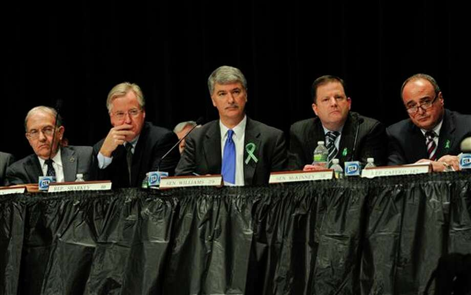 From the left, Connecticut State Senate Majority Leader Martin Looney, Speaker of the House Brendan Sharkey, Senate President Donald Williams Jr., State Senate minority leader John McKinney, and House minority leader Lawrence Cafero, listen to residents of Newtown testify during a hearing of a legislative task force on gun violence and children's safety at Newtown High School in Newtown, Conn., Wednesday, Jan. 30, 2013. Connecticut lawmakers are in Newtown for the hearing, where those invited to give testimony include first responders and families with children enrolled at Sandy Hook Elementary. (AP Photo/Jessica Hill) / FR125654 AP