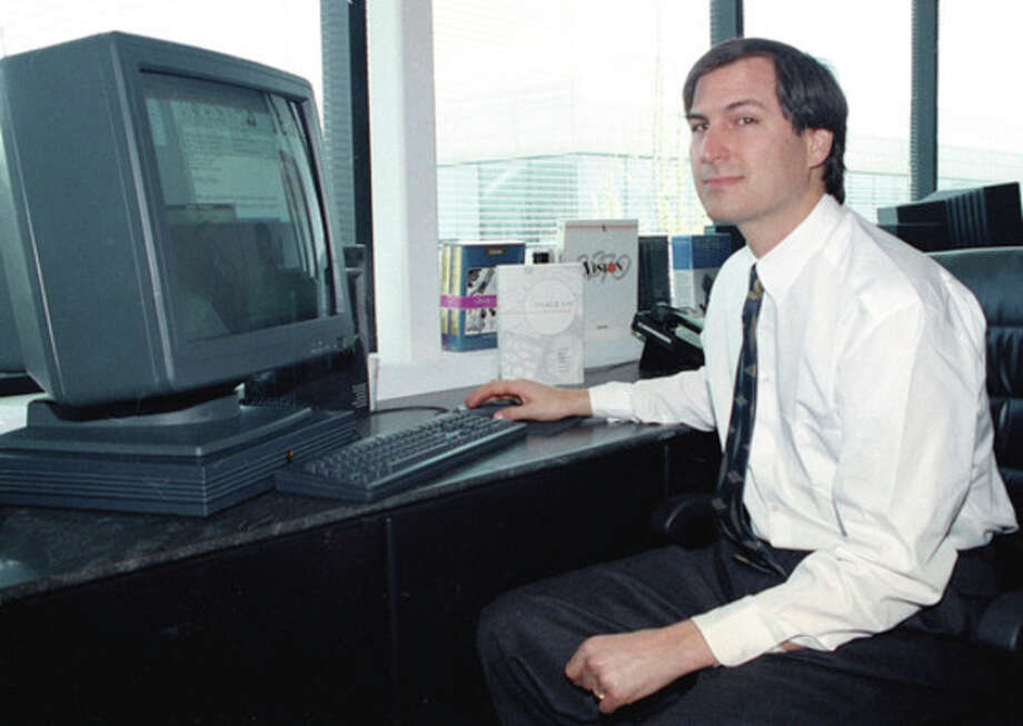 FILE - In this April 4, 1991, file photo, Steve Jobs, of NeXT Computer Inc., poses with his NeXTstation color computer for the press at the NeXT facility in Redwood City, Calif. Apple on Wednesday, Oct. 5, 2011 said Jobs has died. He was 56. (AP Photo/Ben Margot, File) / AP1991