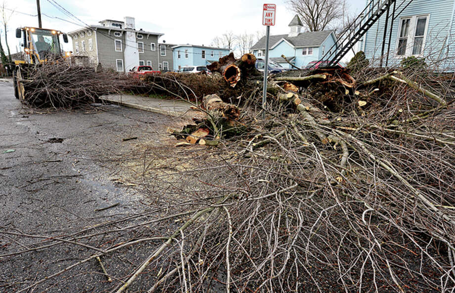 Heavy winds associated with a storm that effected the area early Thursday morning brought down wires and trees throughout Norwalk including a large oak on High St. Hour photo / Erik Trautmann / (C)2012, The Hour Newspapers, all rights reserved
