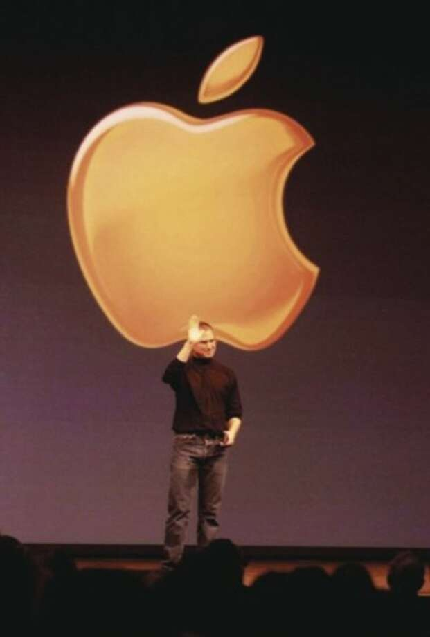 FILE - In this Jan. 5, 2000, file photo, Apple computer co-founder and CEO Steve Jobs waves goodbye to nearly 6,000 Apple faithful after completing his MACWorld Expo keynote address, in San Francisco. Apple on Wednesday, Oct. 5, 2011 said Jobs has died. He was 56. (AP Photo, File)