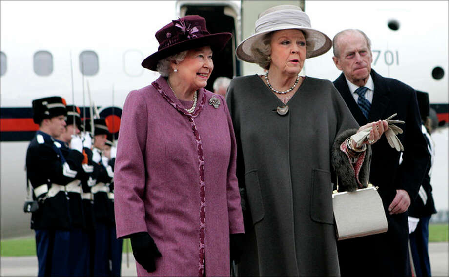 FILE- In this Monday, Feb. 5, 2007 file photo, Britain's Queen Elizabeth II, left, is greeted by Netherlands' Queen Beatrix, center, as Britain's Prince Philip is seen rear right, upon the arrival of the British royal couple at Rotterdam airport, Netherlands. The Dutch Royal House says Queen Beatrix will deliver a nationally televised speech, on Monday, Jan. 28, 2013, and speculation is growing that the popular monarch will announce she is to abdicate. Beatrix, who turns 75 on Thursday, has ruled this nation of 16 million for more than 32 years and would be succeeded by her eldest son, Crown Prince Willem-Alexander. (AP Photo/Robin Utrecht, Pool, File) / AP