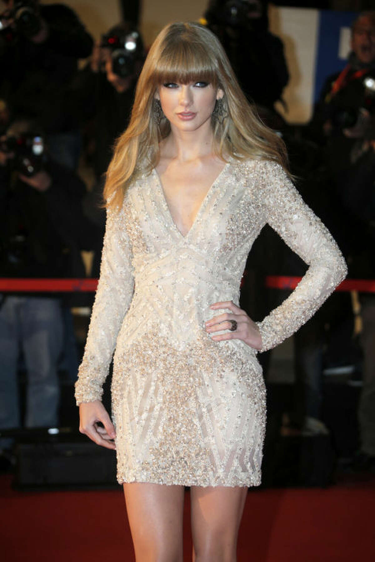 """FILE - This Jan. 26, 2013 file photo shows American singer-songwriter Taylor Swift at the Cannes festival palace, to take part in the NRJ Music awards ceremony in Cannes, southeastern France. Swift says you can expect some of her bolder choices of late, from her music to her new, sexier image, to be incorporated in her upcoming tour. Swift kicks off her worldwide tour in Omaha, Neb., next month in support of her latest album, ?""""Red.?"""" (AP Photo/Lionel Cironneau, file)"""