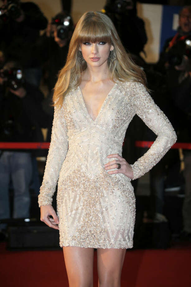 "FILE - This Jan. 26, 2013 file photo shows American singer-songwriter Taylor Swift at the Cannes festival palace, to take part in the NRJ Music awards ceremony in Cannes, southeastern France. Swift says you can expect some of her bolder choices of late, from her music to her new, sexier image, to be incorporated in her upcoming tour. Swift kicks off her worldwide tour in Omaha, Neb., next month in support of her latest album, ""Red."" (AP Photo/Lionel Cironneau, file)"