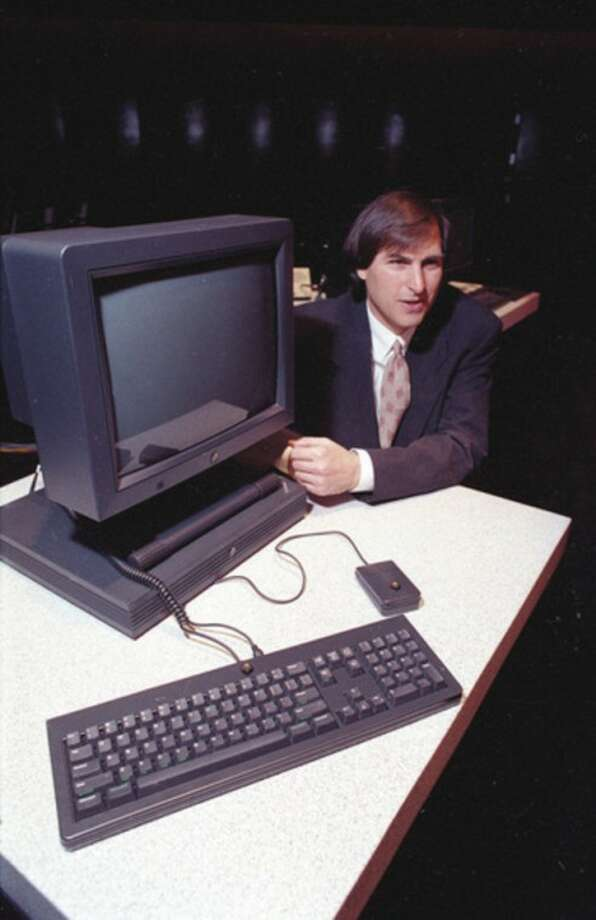 FILE - In this Sept. 18, 1990, file photo, Steve Jobs, president and CEO of NeXT Computer Inc., shows off his company's new NeXTstation after an introduction to the public in San Francisco. Apple on Wednesday, Oct. 5, 2011 said Jobs has died. He was 56. (AP Photo/Eric Risberg, File)