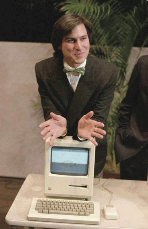 FILE - In this Jan. 24, 1984, file photo, Steve Jobs, chairman of the board of Apple Computer, leans on the new