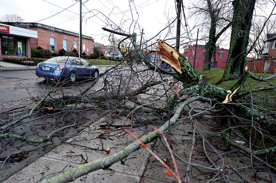 Heavy winds associated with a storm that effected the area early Thursday morning brought down wires and trees throughout Norwalk including Main St. Hour photo / Erik Trautmann / (C)2012, The Hour Newspapers, all rights reserved
