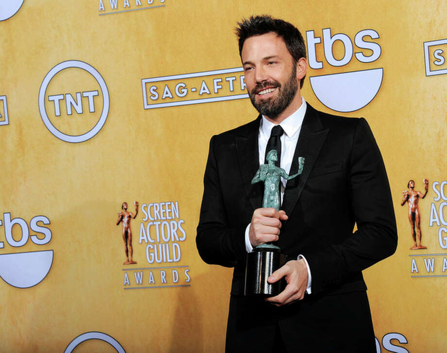 "FILE - In this Sunday, Jan. 27, 2013 file photo, actor Ben Affleck poses backstage with the award for best cast in a motion picture for ""Argo"" at the 19th Annual Screen Actors Guild Awards at the Shrine Auditorium in Los Angeles. A best-picture win at the upcoming Oscars could be viewed as righting a wrong after Affleck inexplicably missed out on a best-director nomination. (Photo by Chris Pizzello/Invision/AP, File) / Invision"