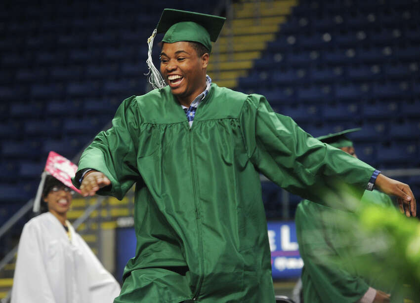 Graduate Isiah Boyd dances across the stage to pick up his diploma during the Bassick High School graduation at the Webster Bank Arena in Bridgeport, Conn. on Tuesday, June 14, 2016.