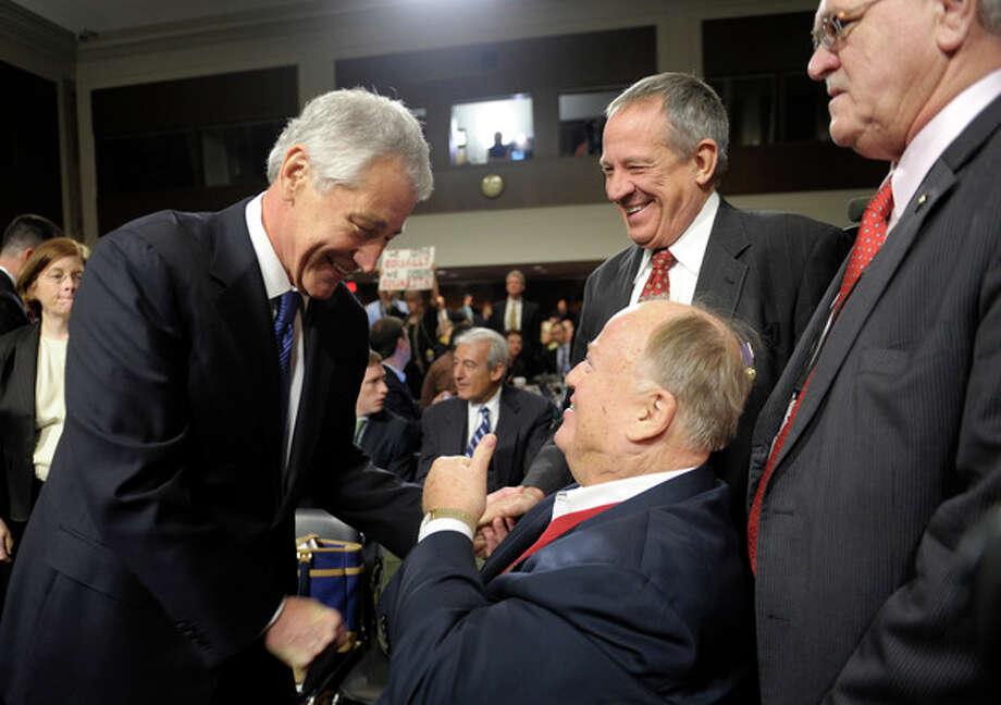 Former Nebraska Republican Sen. Chuck Hagel, left, President Barack Obama's choice for defense secretary, greets former Georgia Sin. Max Cleland, center, after arriving on Capitol Hill in Washington, Thursday, Jan. 31, 2013, to testify before the Senate Armed Services Committee hearing on his nomination. (AP Photo/Susan Walsh) / AP