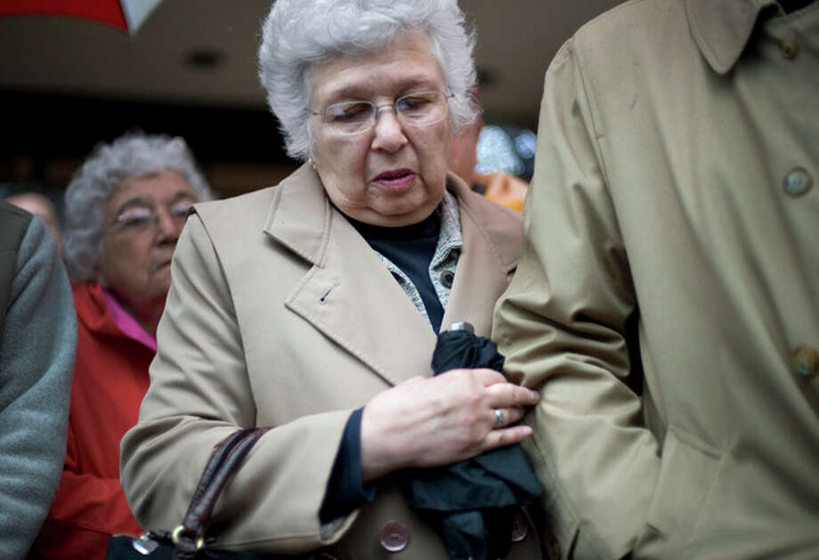 Barbara Petit, mother of William Petit Jr., stands with family outside Superior Court in New Haven after the formal sentencing of Joshua Komisarjevsky in New Haven, Conn., Friday, Jan. 27, 2012. Komisarjevsky is joining co-defendent Steven Hayes on death row for the 2007 killings of Jennifer Hawke-Petit and her daughters, Hayley and Michaela, in their Cheshire home. William Petit Jr. is the sole survivor of the crime. (AP Photo/Jessica Hill) / AP2011