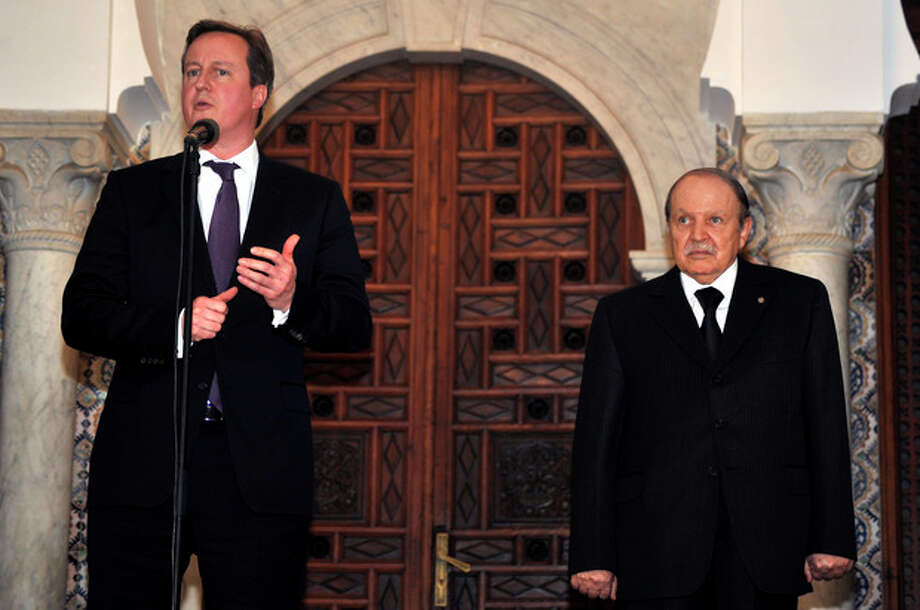 Algerian President Abdelaziz Bouteflika, right, listens to Britain's Prime Minister David Cameron as he delivers a speech in Algiers, Wednesday, Jan. 30, 2013. Britain and Algeria agreed to a security partnership that could see greater intelligence-sharing and planning for future crises, Cameron said Wednesday on a visit to the North African country. (AP Photo/Anis Belghoul) / AP