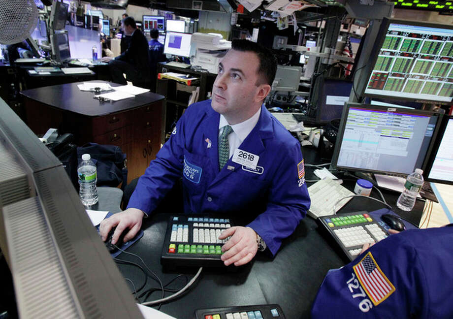 Specialist James Sciulli works at his post on the floor of the New York Stock Exchange Monday, Feb. 27, 2012. U.S. stocks pulled back Monday from some of their highest levels in three and a half years. (AP Photo/Richard Drew) / AP