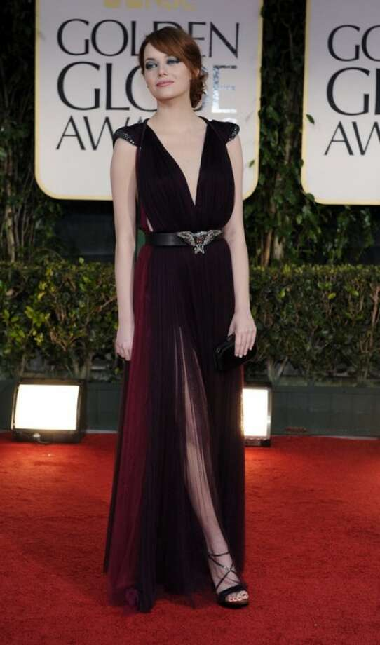 Emma Stone arrives at the 69th Annual Golden Globe Awards Sunday, Jan. 15, 2012, in Los Angeles. (AP Photo/Chris Pizzello)