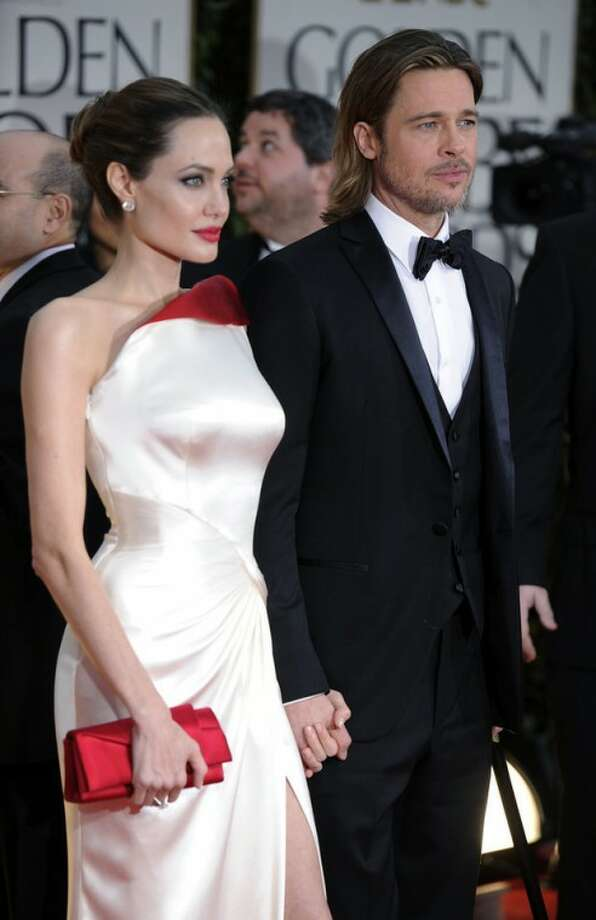 Angelina Jolie and Brad Pitt arrive at the 69th Annual Golden Globe Awards Sunday, Jan. 15, 2012, in Los Angeles. (AP Photo/Chris Pizzello)