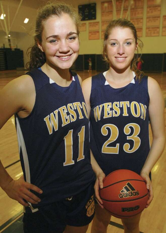 Hour photo/Erik Trautmann Weston will be banking on returning seniors Ellie Martin, left, and Lianna Hursh as it looks to improve on the success it enjoyed last winter. That success came despite an epidemic of injuries sustained by team members.
