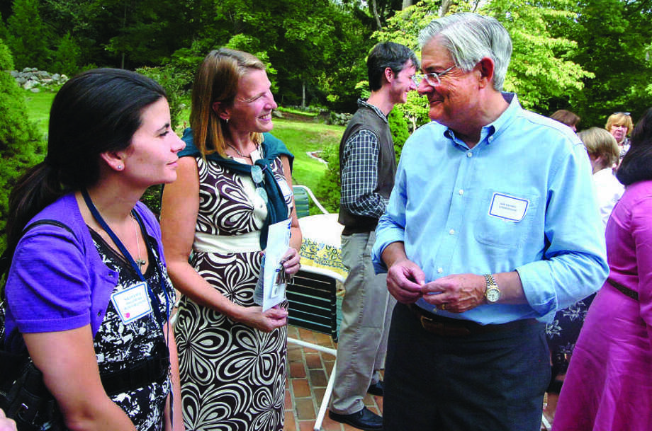 Hour Photo/ Alex von Kleydorff. Dr Gary Richards Wilton Superintendent of Schools talks with Nicole Mok and Jo Gallagher at the new teacher reception Monday in Wilton.