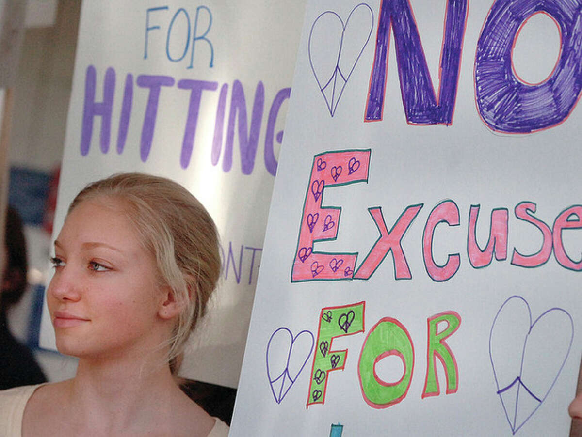 Hour Photo Alex von Kleydorff; Julia Bunte-Mein from Greenwich High School stands at The Stamford Government Center with others from area schools to launch National Teen Dating Violence Awareness and Prevention Month