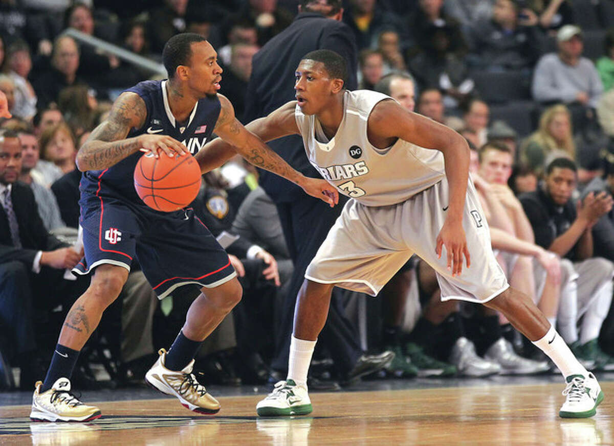 AP photo Providence guard Kris Dunn, right, defends Connecticut guard Ryan Boatright during the first half of Thursday night's game at the Dunkin' Donuts Center in Providence. Boatright had a team-high 19 points in the Huskies' 82-79 overtime victory.