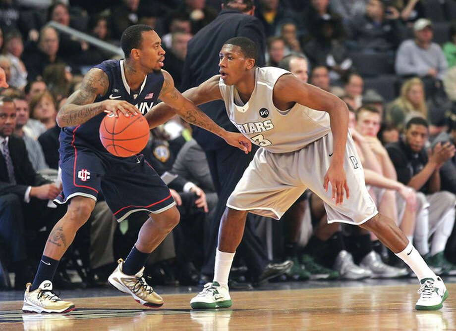 AP photoProvidence guard Kris Dunn, right, defends Connecticut guard Ryan Boatright during the first half of Thursday night's game at the Dunkin' Donuts Center in Providence. Boatright had a team-high 19 points in the Huskies' 82-79 overtime victory. / FR56276 AP