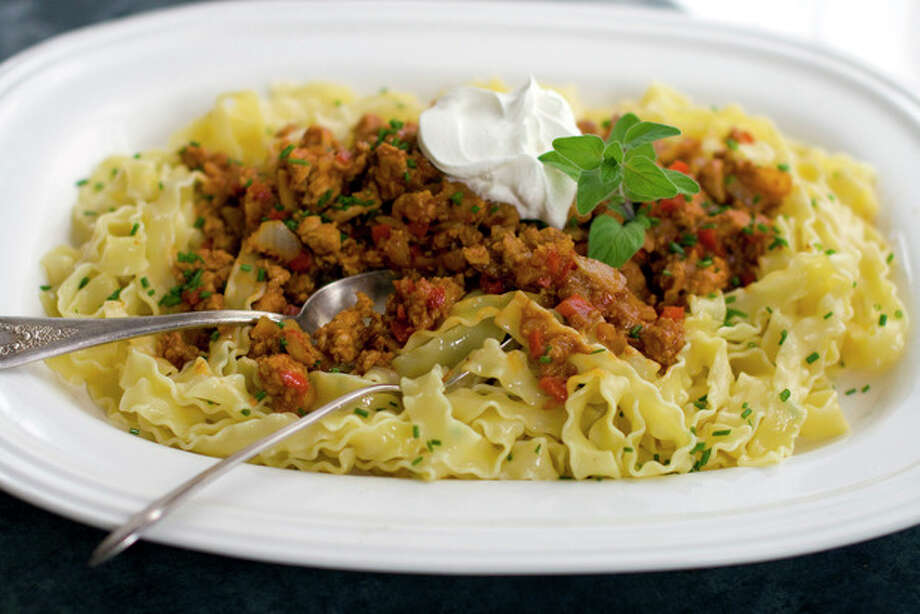This April 25, 2011 photo shows chipotle barbecue porky pappardelle in Concord, N.H. Before serving this dish, top with a dollop of sour cream and a sprinkle of chives. (AP Photo/Matthew Mead) / FR170582 AP