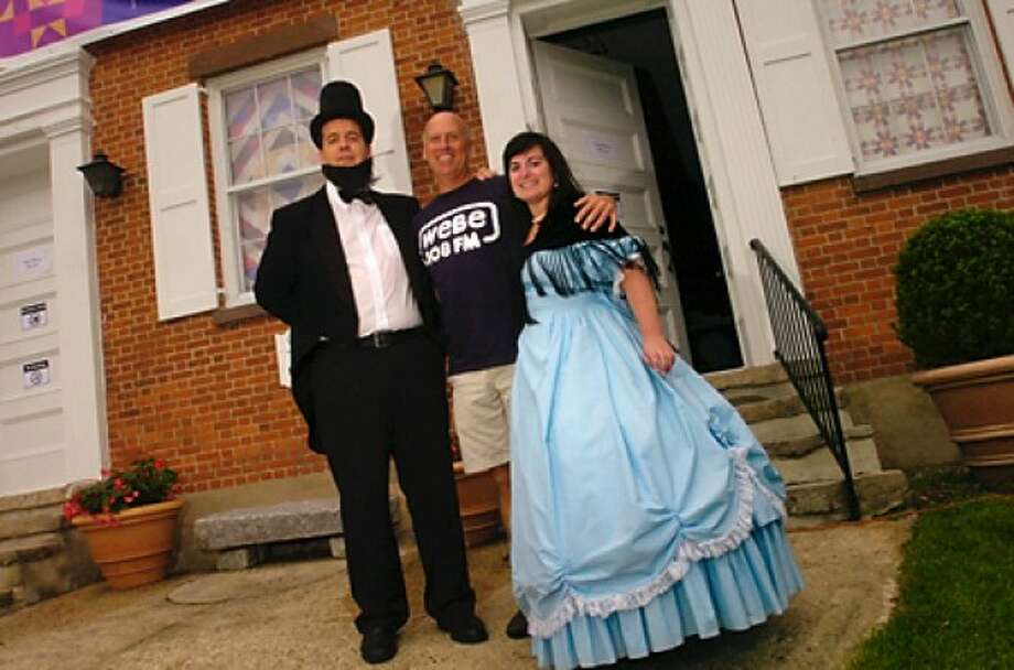 Robbie Bridges, Tom Arbron and Eryn Crane of WEBE 108 don historic garb as sponsors for the Taste of History: Civil War fundraiser Saturday at Mill Hill Historic Park. Hour photo / Erik Trautmann
