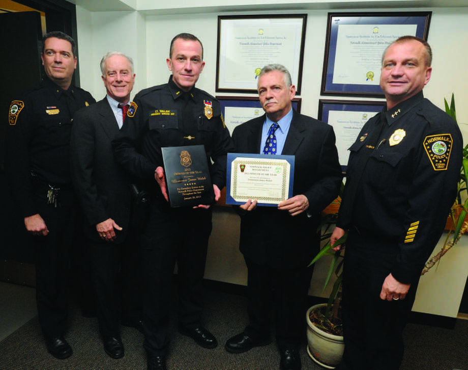 Officer of the year award at Norwalk Police Headquarters. From left, Deputy Police Chief David Wrinn, Police Commisioner Dan O'Connor, Officer of the year, Lt. James Walsh, Police Commisioner Pete Torrano and Police Chief Thomas E. Kulhawik. hour photo/Matthew Vinci