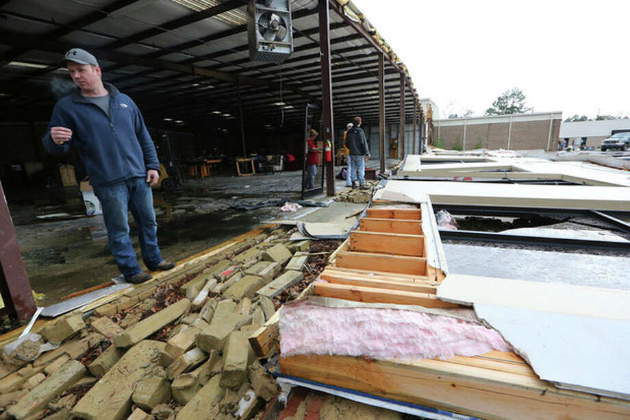 Marshall Faulkner surveys damage to his family's business in Tupelo, Mississippi on Wednesday, January 30, 2013. Pre-dawn winds destroyed the facade of The Furniture Center and damaged several nearby businesses sharing the Huntington Square shopping center off McCullough Boulevard.(AP Photo/The Northeast Mississippi Daily Journal, C. Todd Sherman) / The Northeast Ms Daily Journal