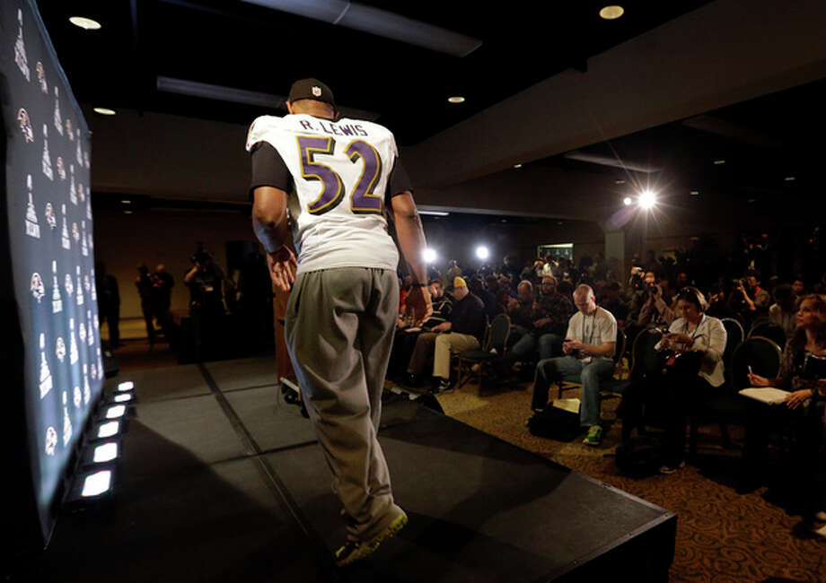 Baltimore Ravens linebacker Ray Lewis walks onstage to speak at an NFL Super Bowl XLVII football news conference on Wednesday, Jan. 30, 2013, in New Orleans. The Ravens face the San Francisco 49ers in Super Bowl XLVII on Sunday, Feb. 3. (AP Photo/Patrick Semansky) / AP