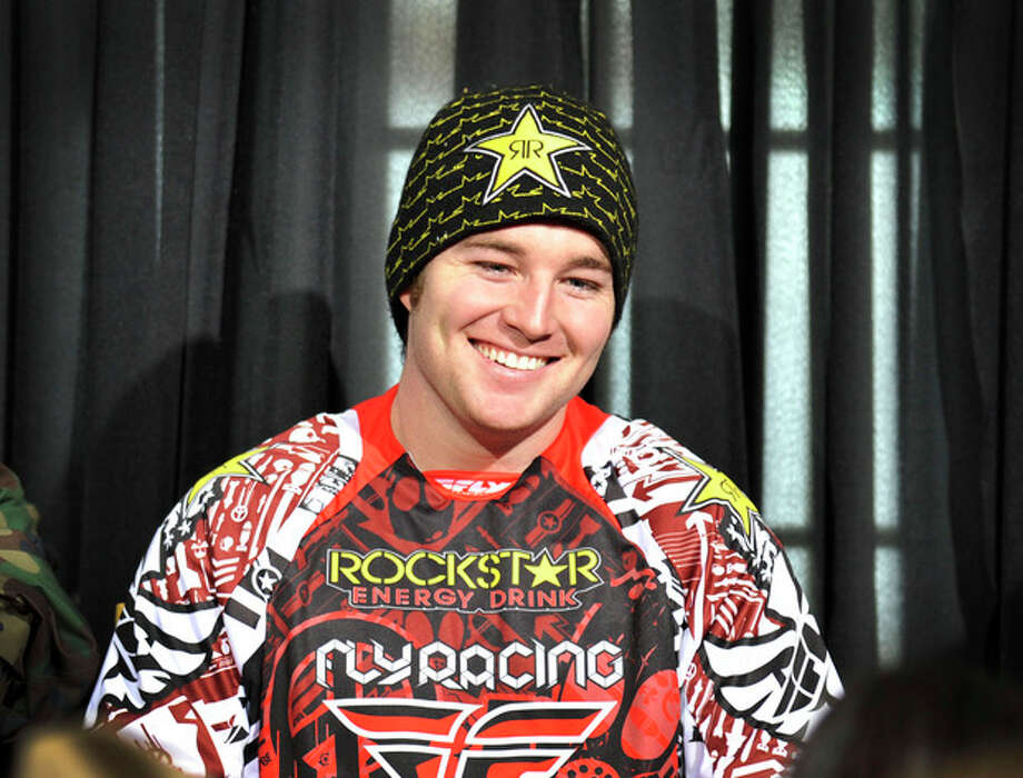 In this photo taken Jan. 25, 2012 and released by ESPN Images, snomobiler Caleb Moore smiles while attending a news conference at the Winter X Games in Aspen, Colo. Moore was in critical condition on Tuesday, Jan. 29, 2013, in a Colorado hospital after a dramatic crash at the Winter X Games in Aspen, and a relative said the family wasn't hopeful about the 25-year-old's chances for survival. (AP Photo/ESPN Images, Eric Lars Bakke) / ESPN Images