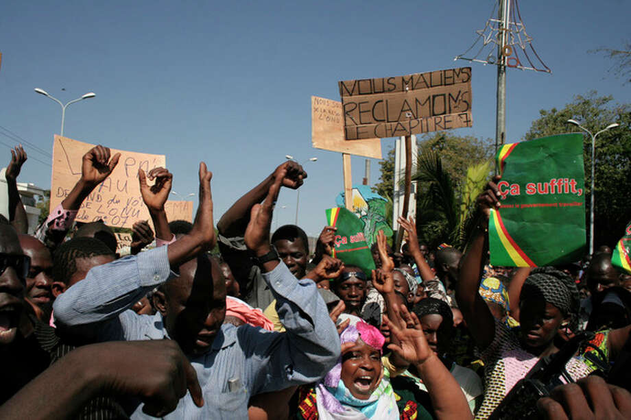 FILE - In this Dec. 8, 2012, file photo, Malians demonstrate in favor of an international military intervention to regain control of the country's Islamist-controlled north, in Bamako, Mali. They carry signs that say 'That's enough, let the government work' right, and 'We Malians Demand Chapter 7,' center, referring to the chapter of the United Nations Charter which would be used to authorize international military intervention. The Pentagon is moving toward setting up a military base in northwest Africa from which to operate surveillance drones to collect intelligence on Islamic militants in the region, several U.S. defense officials said Tuesday, Jan. 29, 2013. The officials, speaking on condition of anonymity because the plan is still in the works, said the base in Niger would position the U.S. to provide more help to French troops fighting al-Qaida-backed militants in neighboring Mali. (AP Photo/Harouna Traore) / AP