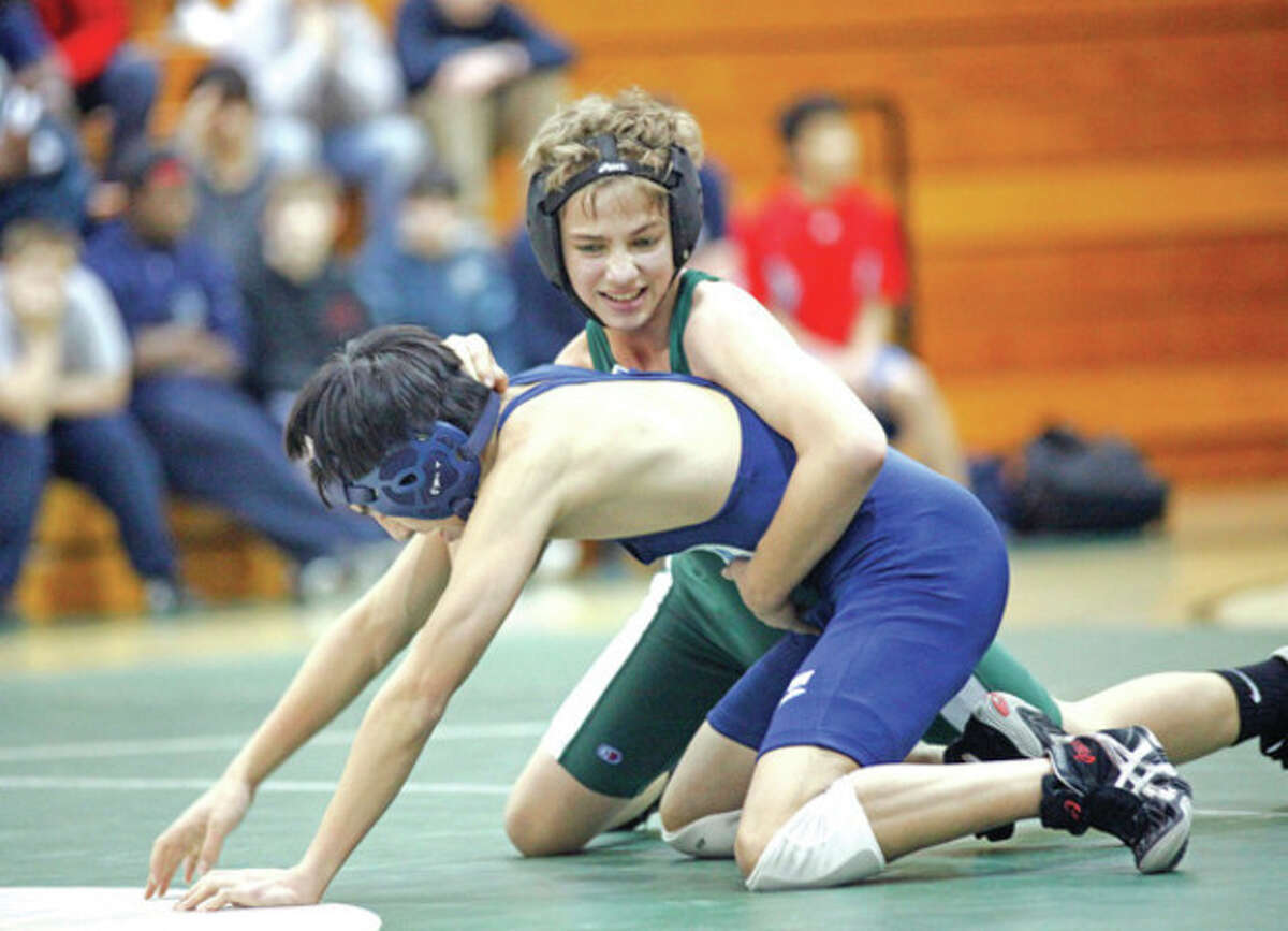 Luke Schwartz from Norwalk wrestles Andrew Lee from Wilton during a match at Norwalk High School Tuesday evening. Hour Photo / Danielle Robinson