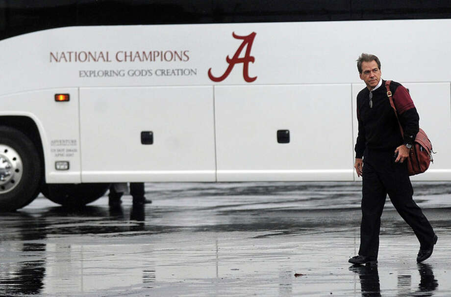 Coach Nick Saban heads towards fans at the Tuscaloosa Regional Airport after he and the University of Alabama football team returned to Tuscaloosa, Ala., Tuesday, Jan. 10, 2012, after beating LSU to win the BCS National Championship title. (AP Photo/The Birmingham News, Tamika Moore) / The Birmingham News