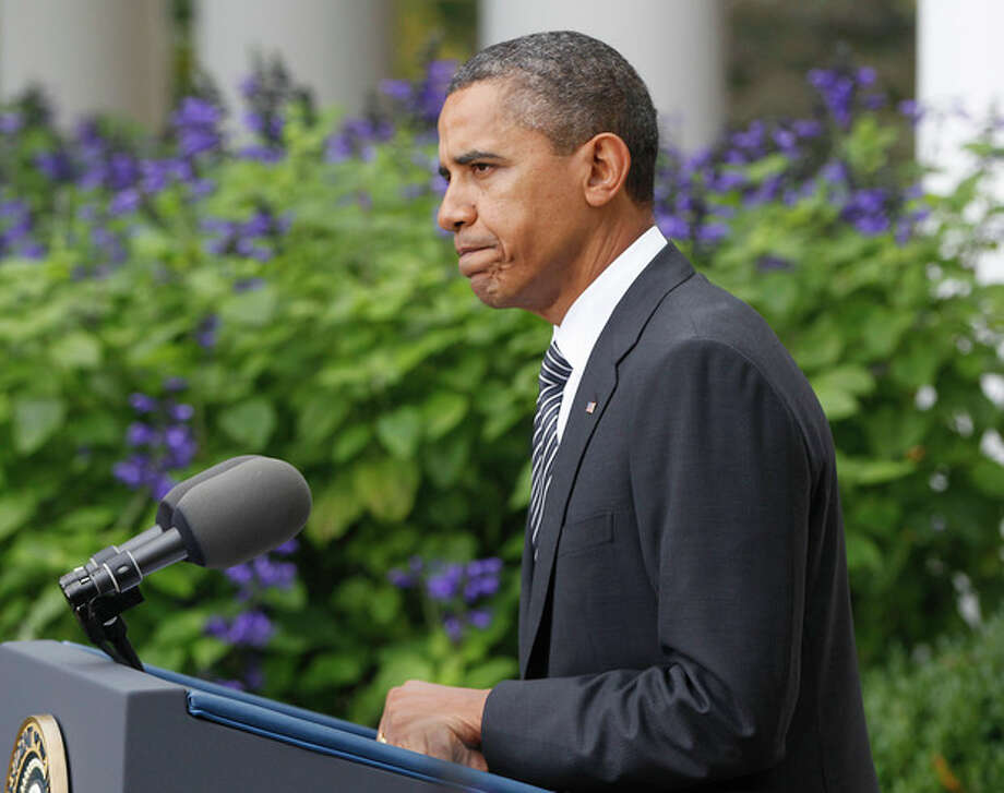 President Barack Obama speaks in the Rose Garden of the White House in Washington, Thursday, Oct. 20,2011, to discuss the death of Libyan leader Moammar Gadhafi. (AP Photo/Charles Dharapak) / AP