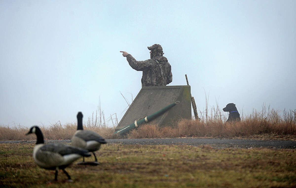 A goose hunter waits in the fog at Veteran's Memorial Park or his quarry on Wednesday morning. Hour photo / Erik Trautmann