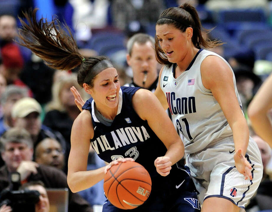 Connecticut's Stefanie Dolson, right, defends Villanova's Laura Sweeney during the first half of an NCAA college basketball game in Hartford, Conn., Tuesday, Jan. 29, 2013. (AP Photo/Fred Beckham) / FR153656 AP
