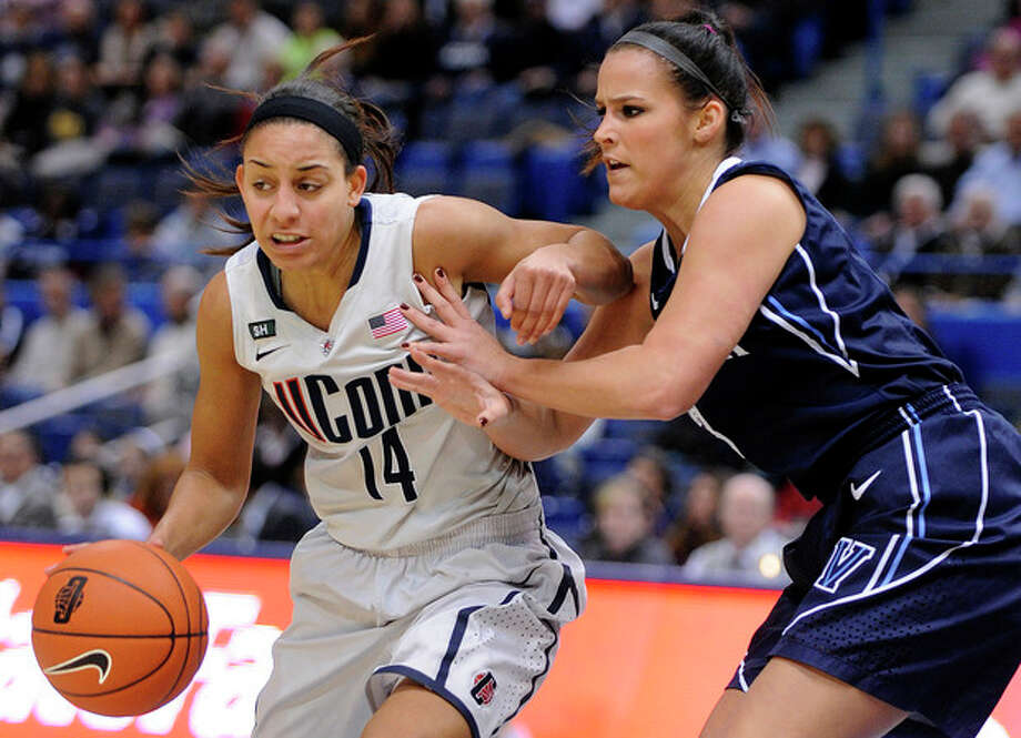 Connecticut's Bria Hartley, left, drives past Villanova's Jesse Carey during the first half of an NCAA college basketball game in Hartford, Conn., Tuesday, Jan. 29, 2013. (AP Photo/Fred Beckham) / FR153656 AP