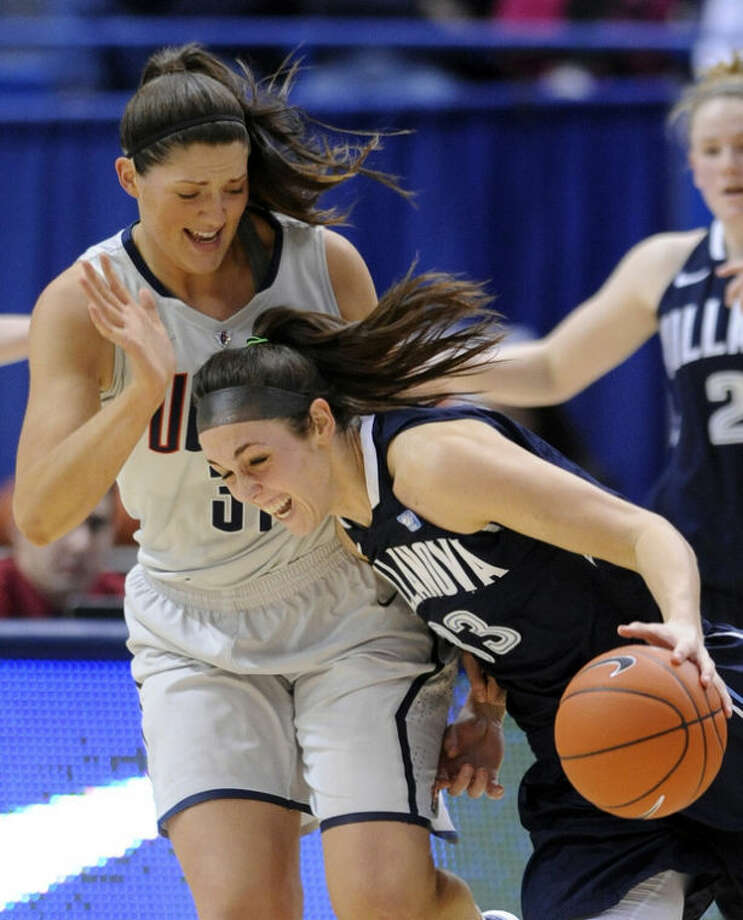 Connecticut's Stefanie Dolson, left, defends Villanova's Laura Sweeney during the first half of an NCAA college basketball game in Hartford, Conn., Tuesday, Jan. 29, 2013. (AP Photo/Fred Beckham)