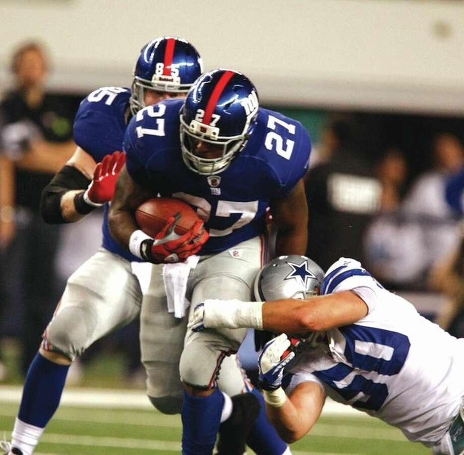 AP photo New York Giants running back Brandon Jacobs battles for yardage against the Dallas Cowboys. The New York run game is finally hitting its stride. / Waco Tribune Herald 2011