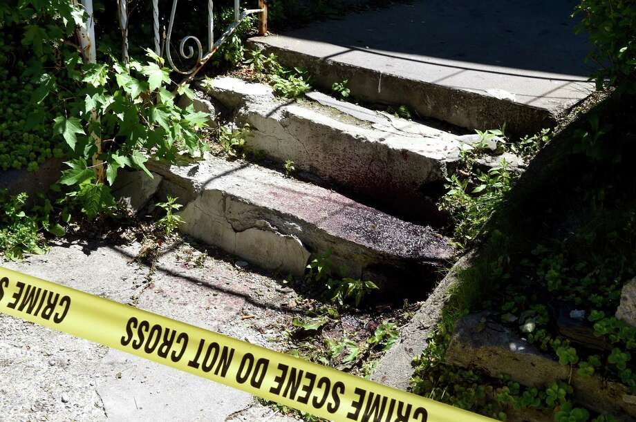 Blood from the scene of a shooting on the front steps of 1339 First Avenue on Tuesday, June 14, 2016, in Schenectady, N.Y. (Cindy Schultz / Times Union) / Albany Times Union